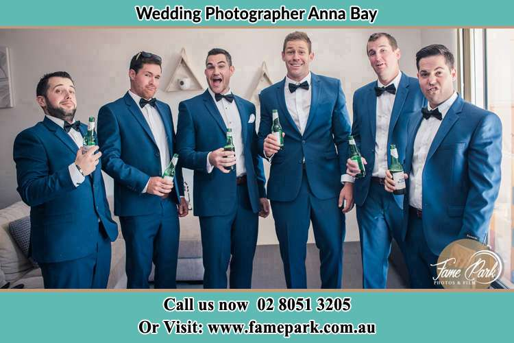 The groom and his groomsmen striking a wacky pose in front of the camera Anna Bay NSW 2316