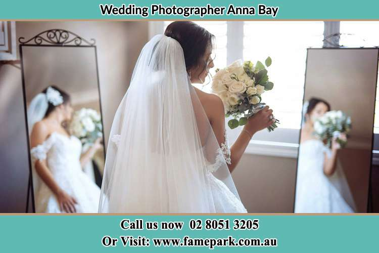 Photo of the Bride holding flower at the front of the mirrors Anna Bay NSW 2316