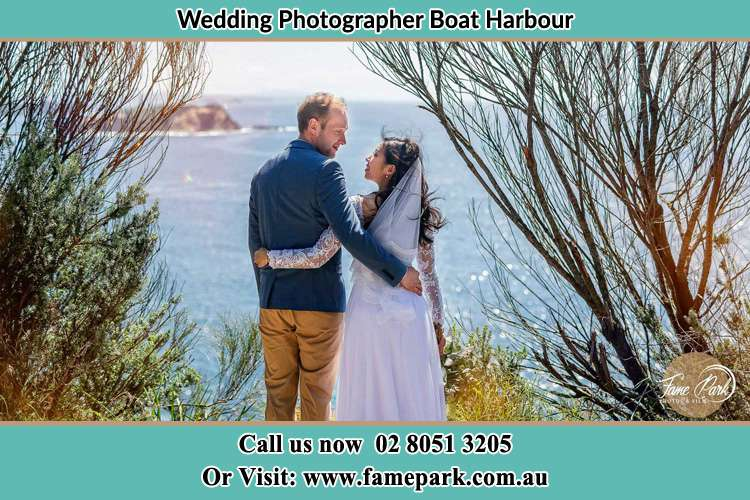 Photo of the Groom and the Bride looking each other near the sea front Boat Harbour NSW 2316