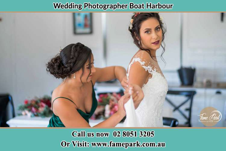 Photo of the Bride and the bridesmaid preparing Boat Harbour NSW 2316
