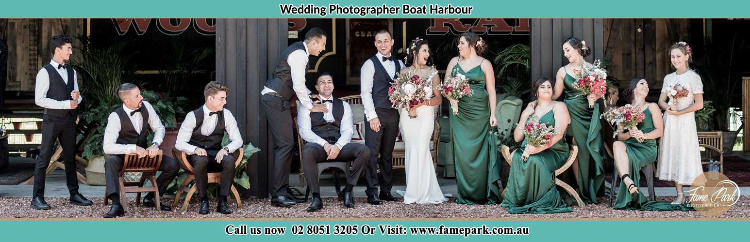 The Bride and the Groom with their entourage pose for the camera Boat Harbour NSW 2316