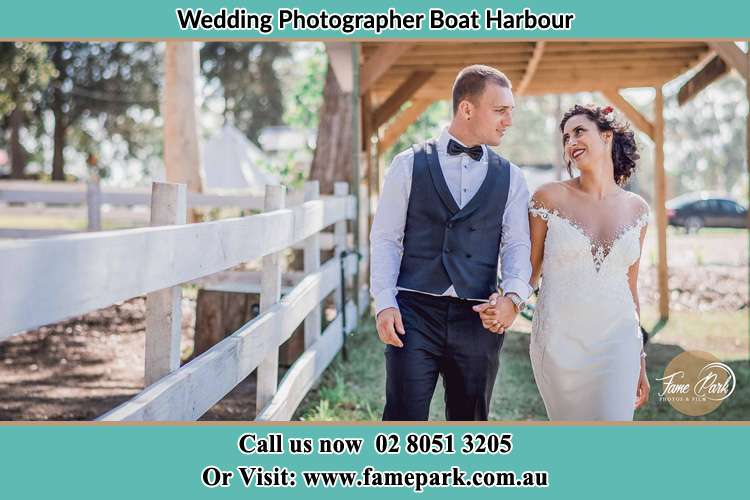 Photo of the Groom and the Bride holding hands while walking Boat Harbour NSW 2316