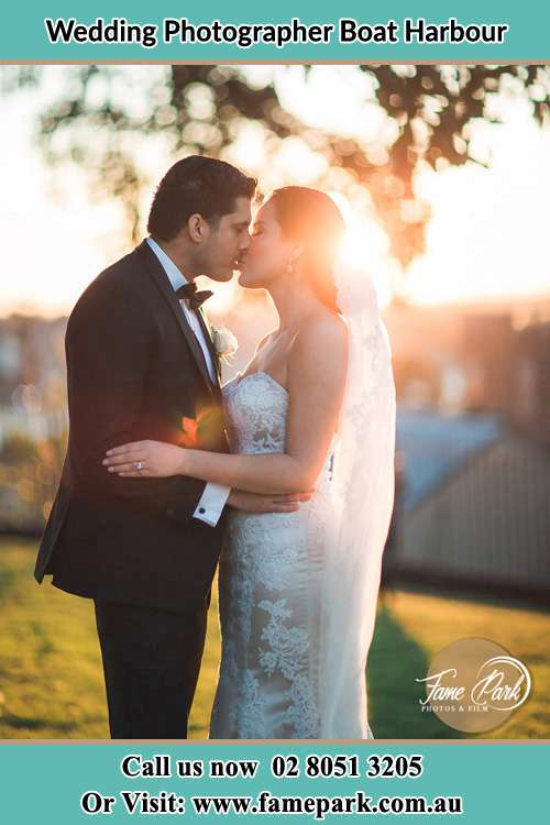 Photo of the Groom and the Bride kissing at the yard Boat Harbour NSW 2316
