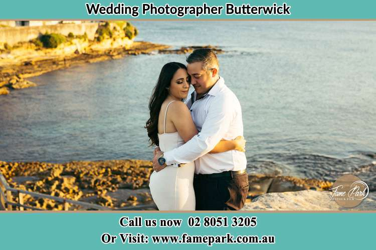 Photo of the Bride and the Groom hugging near the lake Butterwick NSW 2321
