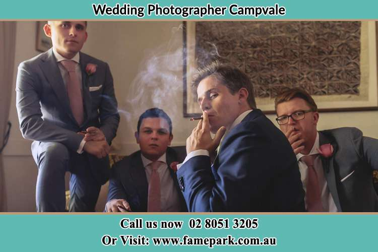 Photo of the Groom and the groomsmen relaxing Campvale NSW 2318