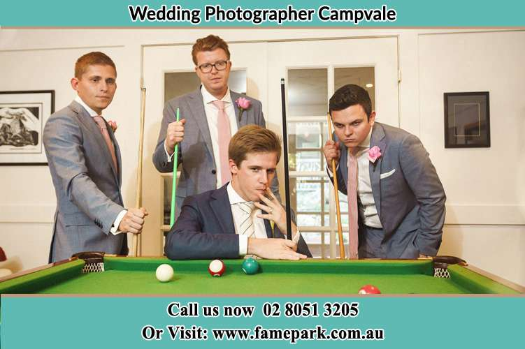 Photo of the Groom and the groomsmen playing billiard Campvale NSW 2318