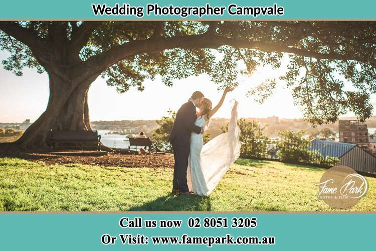 Photo of the Bride and the Groom kissing under the tree Campvale NSW 2318