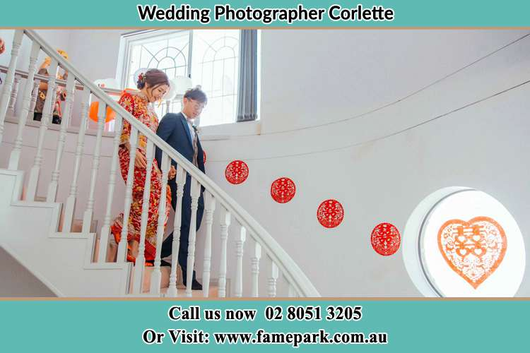 Photo of the Bride and the Groom going down the stair Corlette NSW 2315