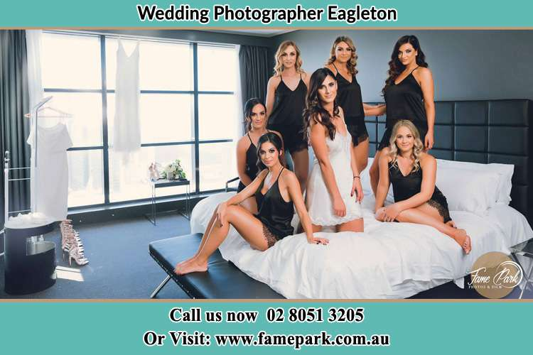 Photo of the Bride and the bridesmaids wearing lingerie on bed Eagleton NSW 2324