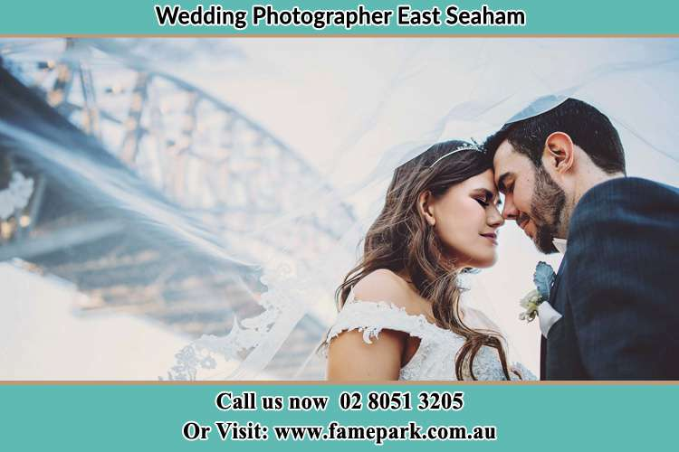 Close up photo of the Bride and the Groom under the bridge East Seaham NSW 2324