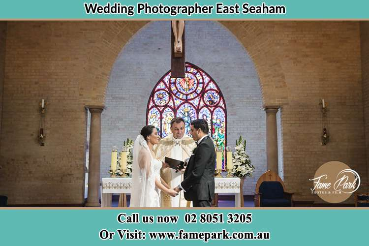 Photo of the Bride and Groom at the Altar with the Priest East Seaham NSW 2324