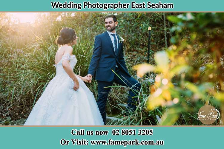 Photo of the Bride and the Groom going up the hill East Seaham NSW 2324