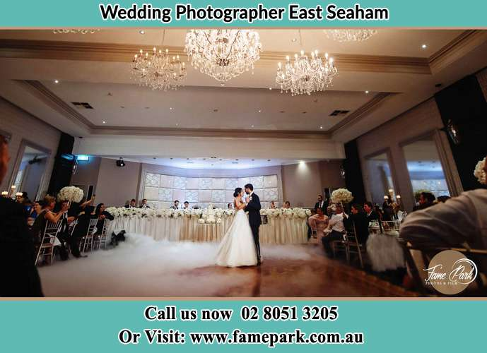 Photo of the Bride and the Groom hugging on the dance floor East Seaham NSW 2324