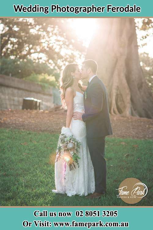 Photo of the Bride and the Groom kissing at the yard Ferodale NSW 2318