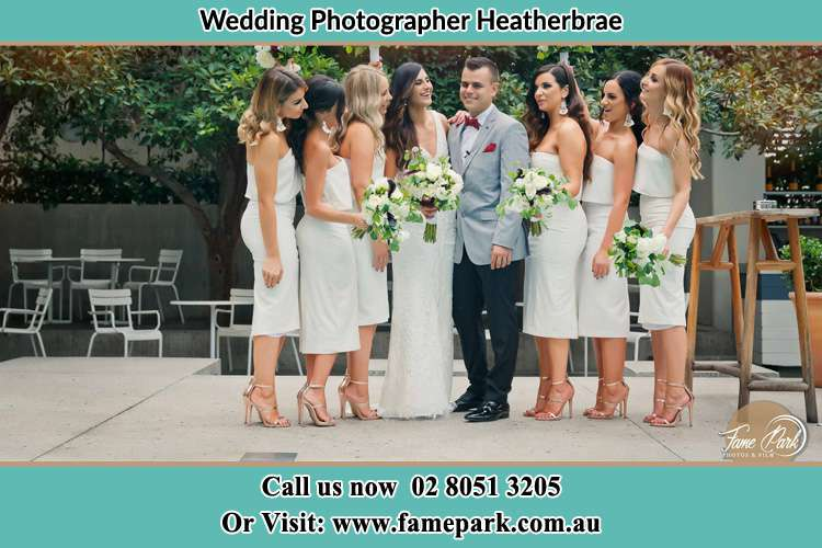 Photo of the Bride and the Groom with the bridesmaids Heatherbrae NSW 2324