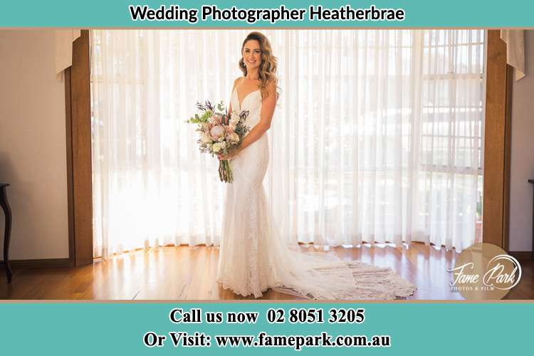 Photo of the Bride holding flower bouquet Heatherbrae NSW 2324