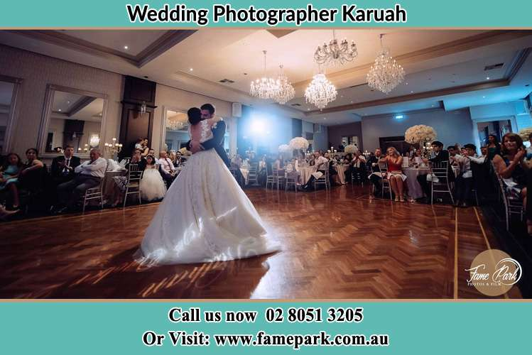 Photo of the Bride and the Groom hugging on the dance floor Karuah NSW 2324