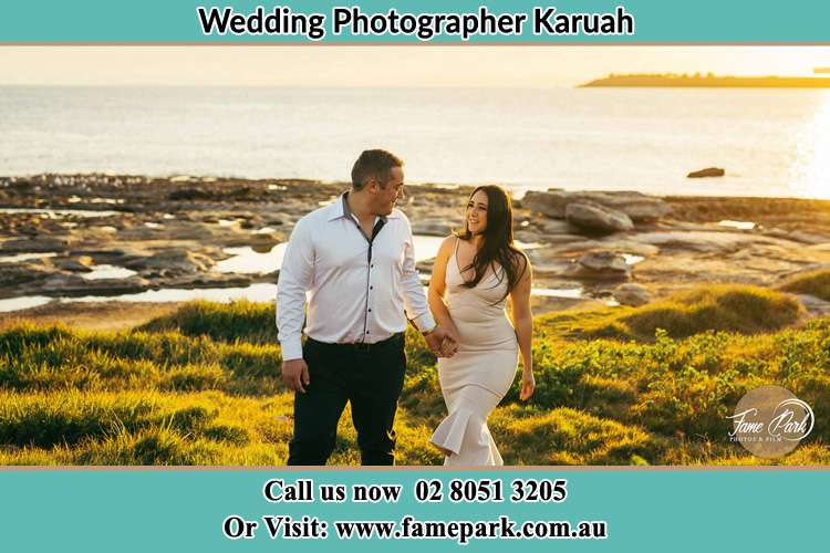 Photo of the Bride and the Groom walking near the lake Karuah NSW 2324