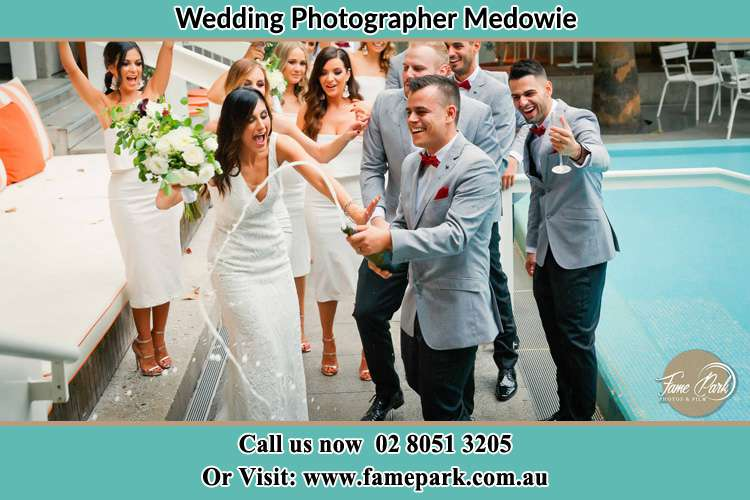 Photo of the Groom and the Bride celebrating with the secondary sponsors Medowie NSW 2318