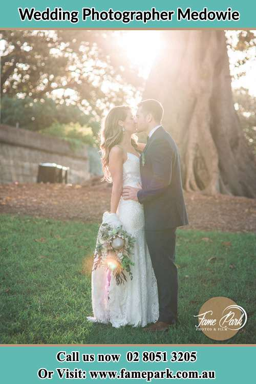 Photo of the Bride and the Groom kissing at the yard Medowie NSW 2318