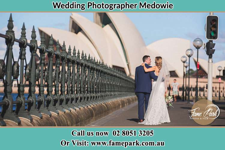 The Groom and the Bride walking towards the Sydney Grand Opera House Medowie NSW 2318