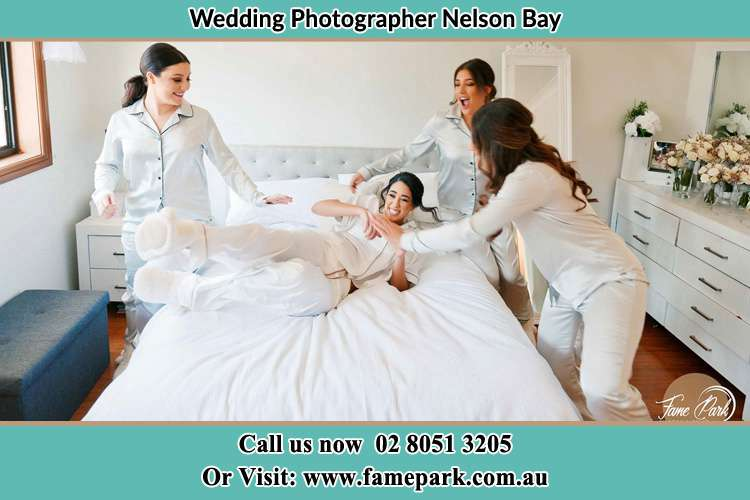 Photo of the Bride and the bridesmaids playing on bed Nelson Bay NSW 2315