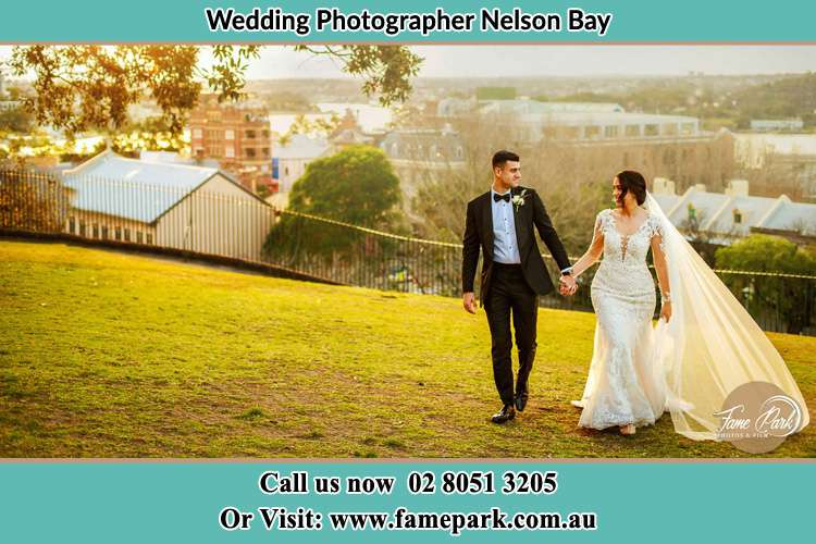 Photo of the Groom and the Bride walking at the yard Nelson Bay NSW 2315
