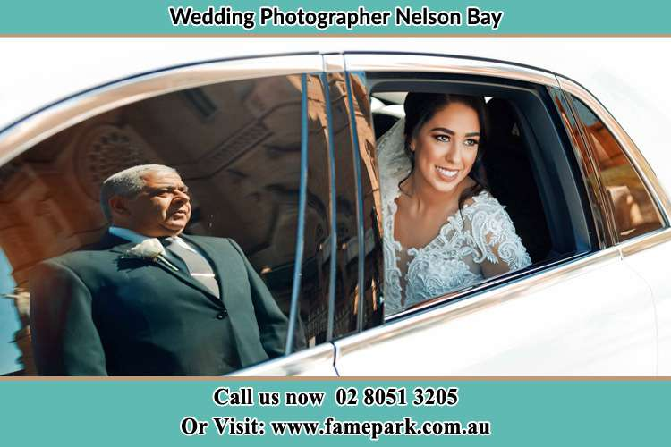Photo of the Bride inside the bridal car with her father standing outside Nelson Bay NSW 2315