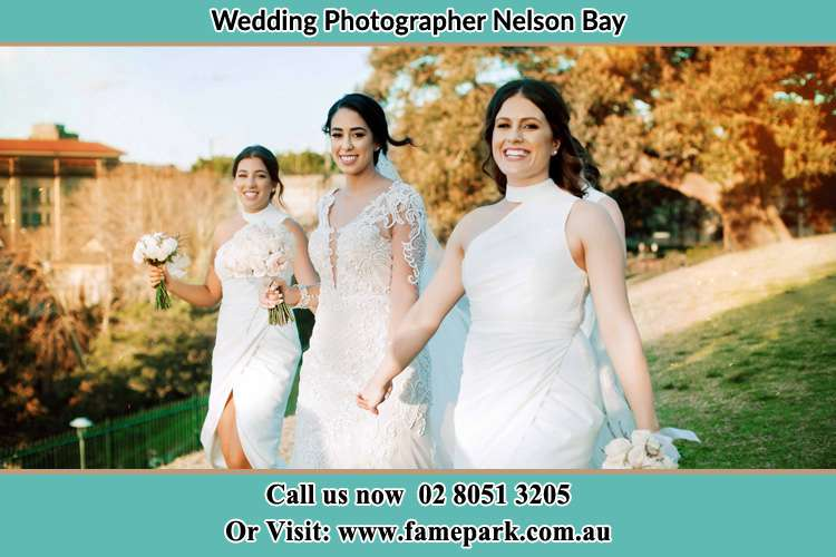Photo of the Bride and the bridesmaids walking Nelson Bay NSW 2315