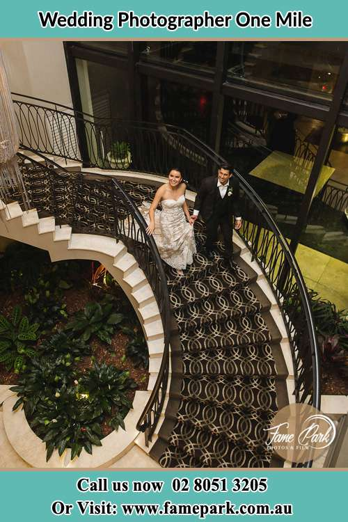 Photo of the Bride and the Groom going down the stair One Mile NSW 2316