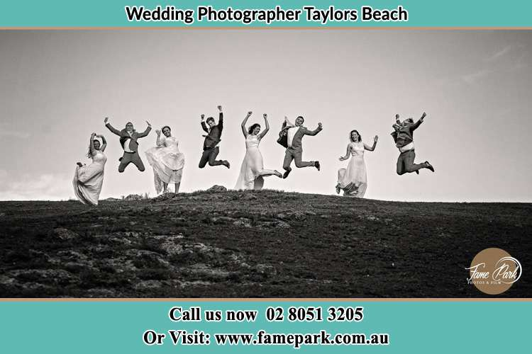 Jump shot photo of the Groom and the Bride with the entourage Taylors Beach NSW 2316