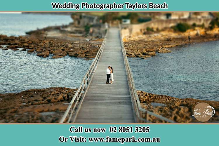 Photo of the Groom and the Bride at the bridge Taylors Beach NSW 2316