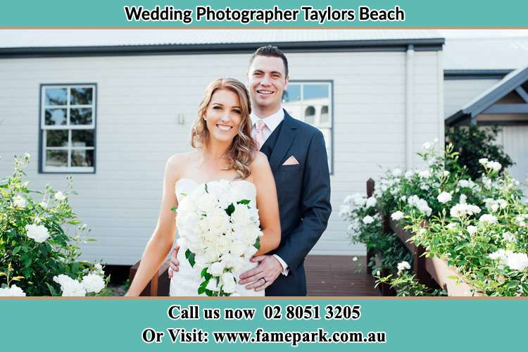Photo of the Bride and the Groom at the front door Taylors Beach NSW 2316
