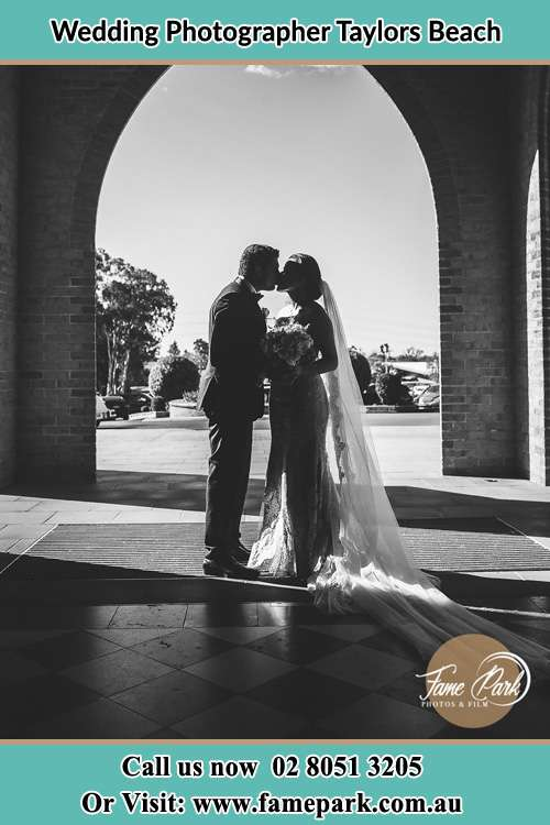 Photo of the Groom and the Bride kissing Taylors Beach NSW 2316
