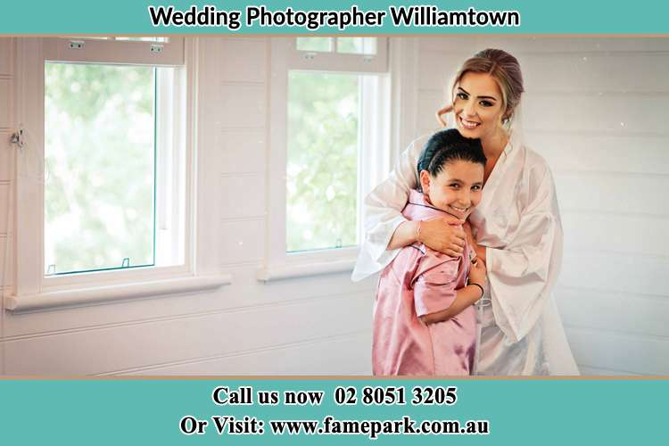 Photo of the Bride hugging the flower girl Williamtown NSW 2318