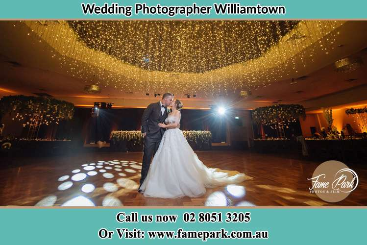 Photo of the Groom and the Bride kissing on the dance floor Williamtown NSW 2318